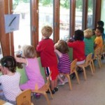 The children lined up at the window to watch the action.